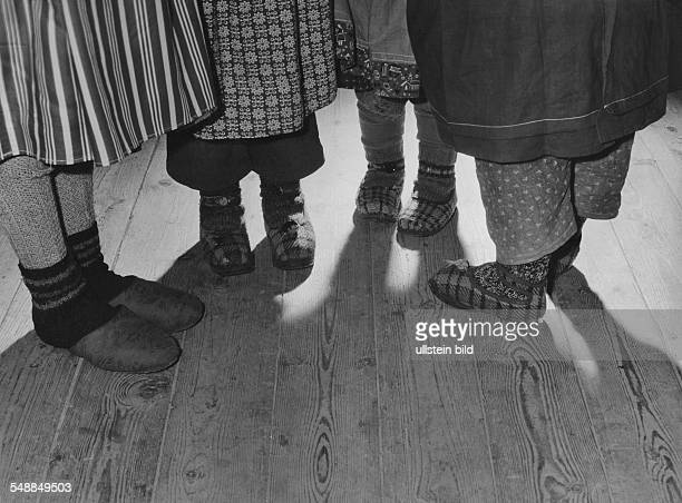 Germany legs of four girls with felt slipper