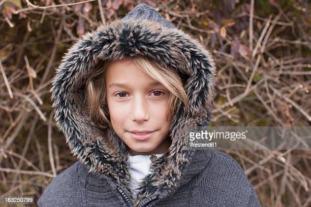 Germany, Leipzig, Boy with fur coat, portrait