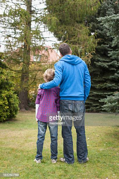 germany, leipzig, father and son looking trees - side by side stock pictures, royalty-free photos & images