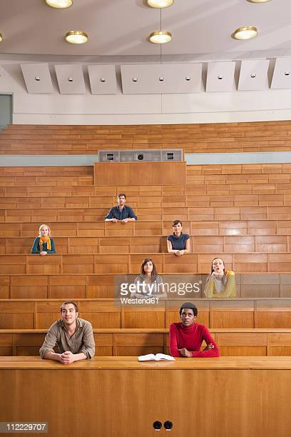 germany, leipzig, group of university students studying in classroom - zuschauerraum stock-fotos und bilder