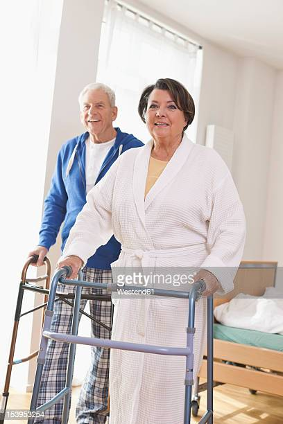 Germany, Leipzig, Senior man and woman with walking frame