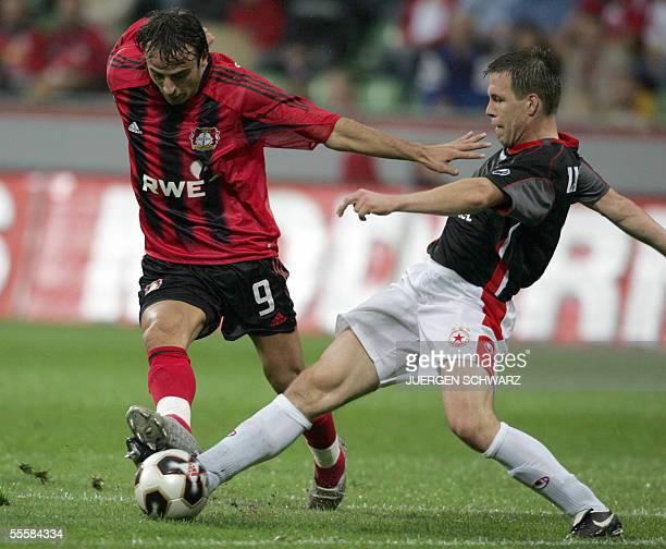 Leverkusen's Bulgarian striker Dimitar Berbatov vies for the ball against Radoslav Zabavnik of Bulgarian club CSKA Sofia during their UEFA Cup first...