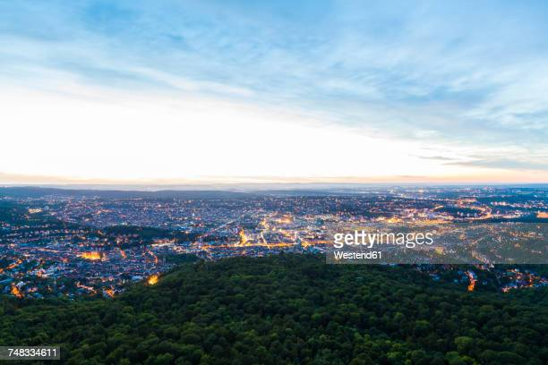 germany, lighted cityscape of stuttgart at twilight - dämmerung stock-fotos und bilder