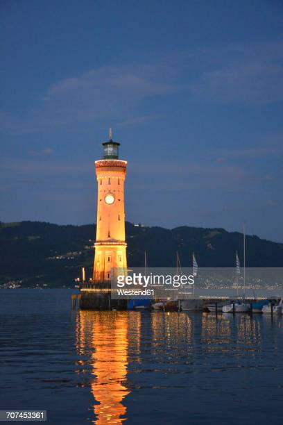 Germany, Lindau, Harbour entrance with lighthouse at sunset