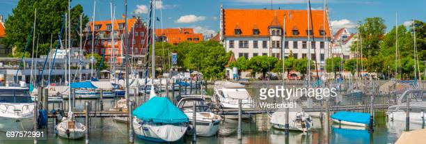 Germany, Lindau, view of port with moored sailing boats and motorboats