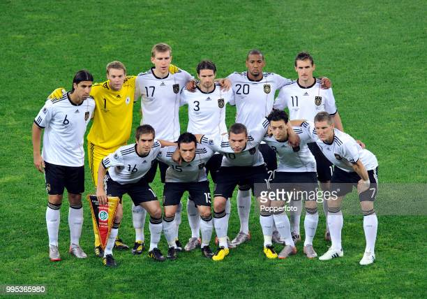 Germany line up for a group photo before the FIFA World Cup Semi Final between Germany and Spain at the Moses Mabhida Stadium on July 7 2010 in...