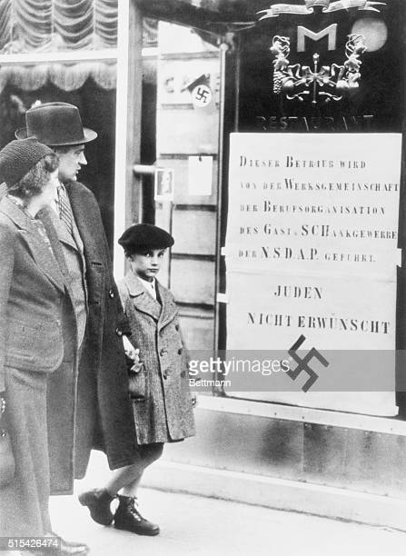 Germany lost little time following its annexation of Austria to Nazify that land Here is a typical Vienna street scene with a notice posted on the...