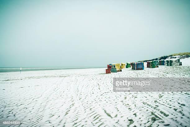 germany, lower saxony, beach chairs at the beach of langeoog - insel langeoog stock-fotos und bilder