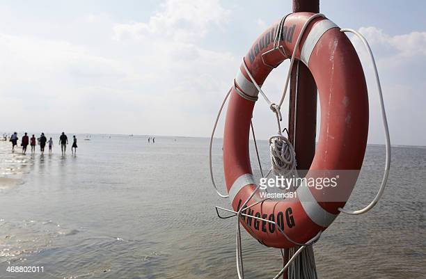 Germany, Lower Saxony, East Frisia, Langeoog, life ring at the beach