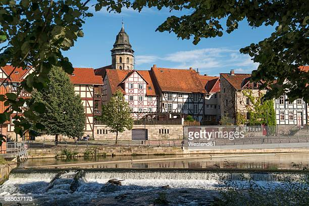 Germany, Lower Saxony, Hannoversch Muenden, townscape with St. Blasius Church at shore of Fulda