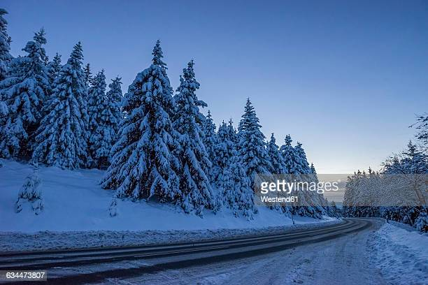 germany, lower saxony, harz national park, mountain road in the evening - 深い雪 ストックフォトと画像