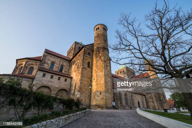 germany, lower saxony, hildesheim, low angle view of saint michaels church - lower saxony stock pictures, royalty-free photos & images