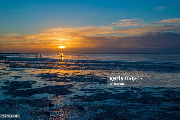 Germany, Lower Saxony, Norden-Norddeich, North Sea coast at sunset