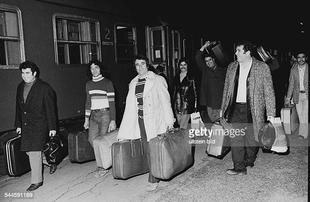 Germany Lower Saxony Wolfsburg Italian immigrant worker on the way to Italia for christmas holidays