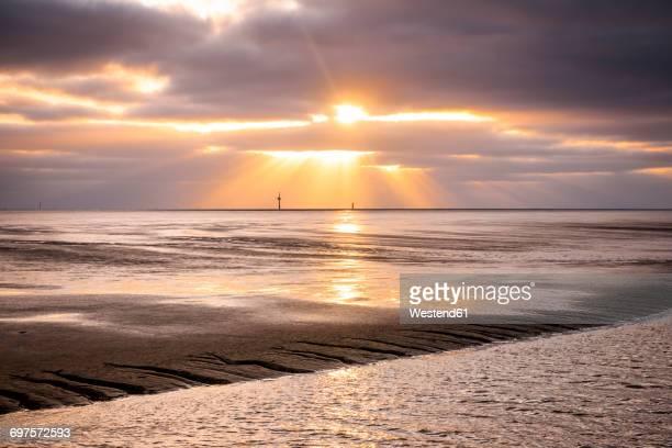 Germany, Lower Saxony, Wremen, tideway at sunset