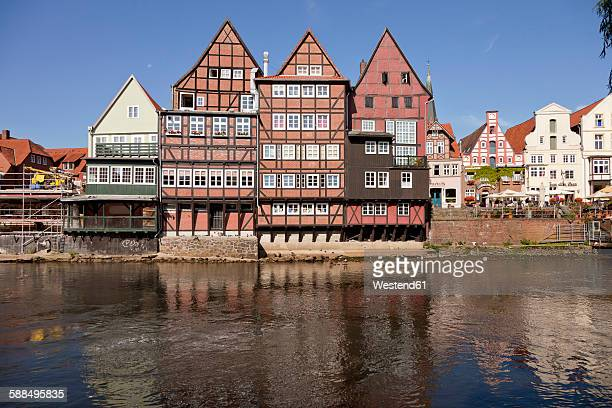 germany, lueneburg, half-timbered and gable houses on ilmenau river - lüneburg stock photos and pictures