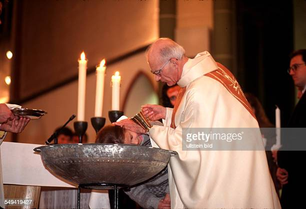 Baptism of foreigners during the Easter mass St Marien Church
