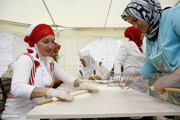 Selimiye mosque preparations for the opening ceremony turkish women prepare the food