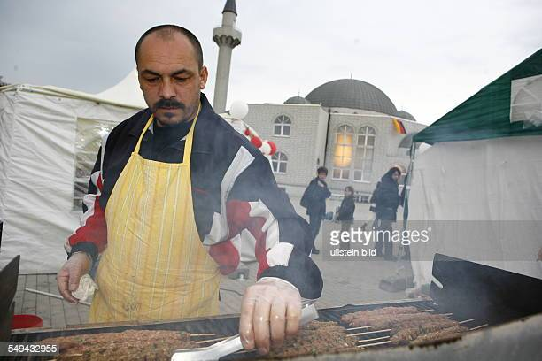 Selimiye mosque preparations for the opening ceremony Turkish man is barbecueing