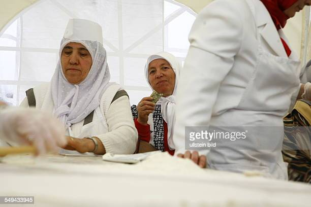 Selimiye mosque preparations for the opening ceremony Turkish women in traditional clothing prepare food
