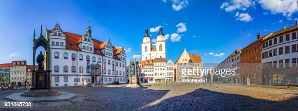 germany, lutherstadt wittenberg, view to town hall, row of houses and st mary's church - saxony anhalt stock pictures, royalty-free photos & images