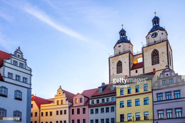 germany, lutherstadt wittenberg, view to town hall, row of houses and st mary's church in the background - lutherstadt wittenberg stock pictures, royalty-free photos & images