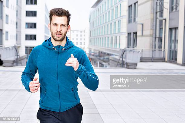 Germany, Magdeburg, portrait of young man jogging