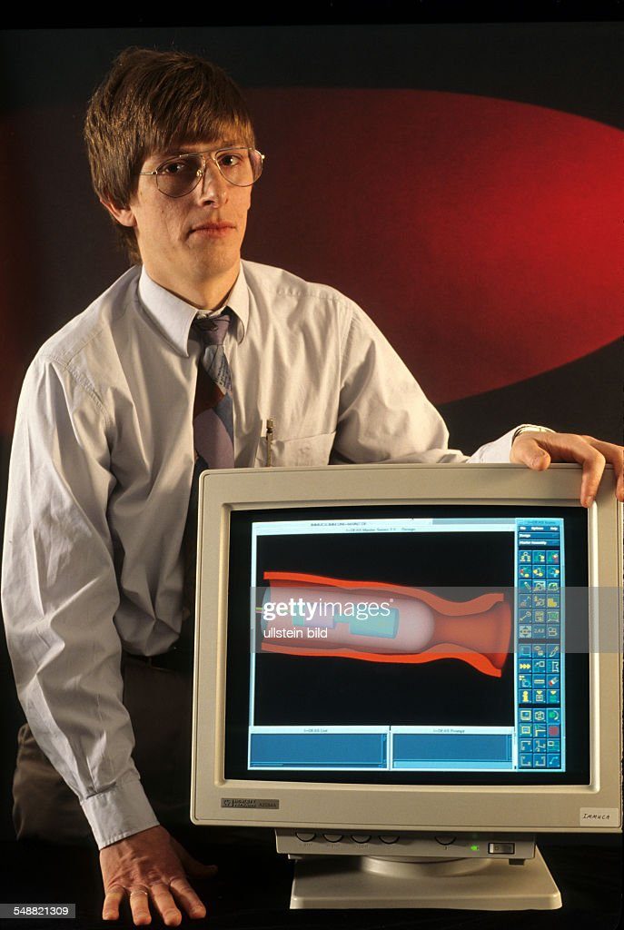 Germany, Mainz: Institute for Micro Technology - Dr.Christoph Schulz showing a graphic of a catheter with micro motor und ultra-sound crystal. - : News Photo