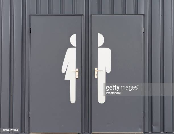 germany, male and female sign on toilet door - symbol stock pictures, royalty-free photos & images