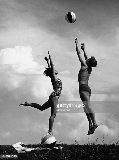 Germany man and woman playing with a beach ball 1950ies