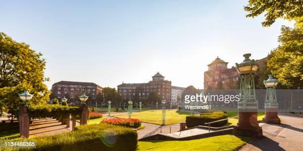 germany, mannheim, friedrichsplatz at backlight - mannheim stock-fotos und bilder