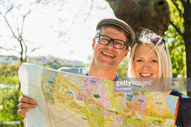 Germany, Mannheim, Mature couple taking city break, looking at map