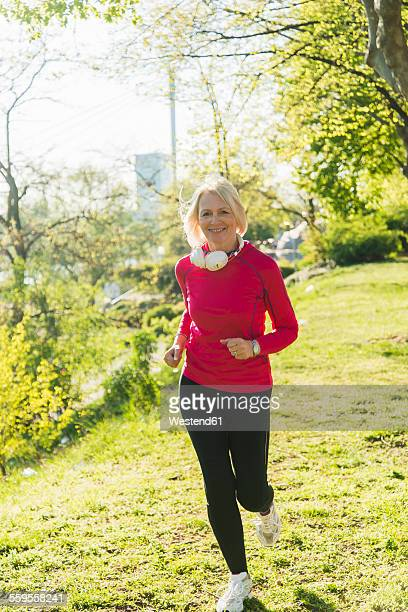 Germany, Mannheim, Mature woman jogging in park