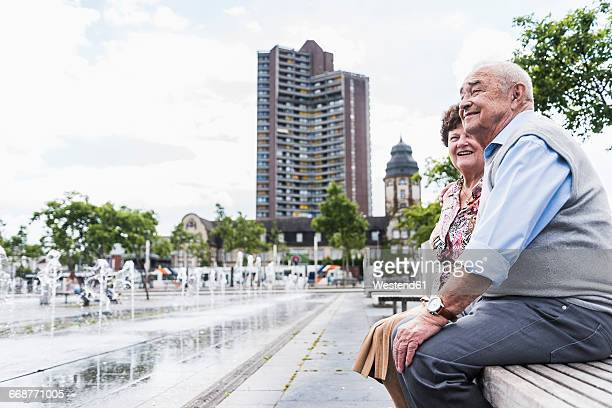 Germany, Mannheim, senior couple sitting together on a bench