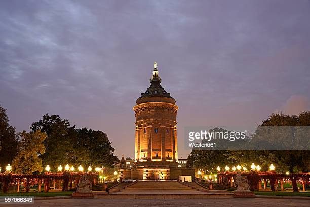 Germany, Mannheim, view to lighted water tower at Friedrichsplatz