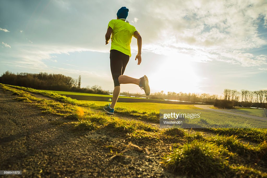 Germany, Mannheim, young man jogging : Foto stock