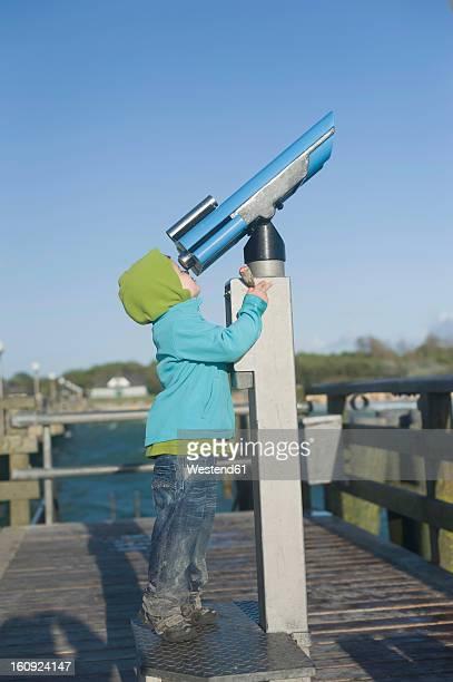 Germany,  Mecklenburg Western Pomerania, Boy looking through telescope