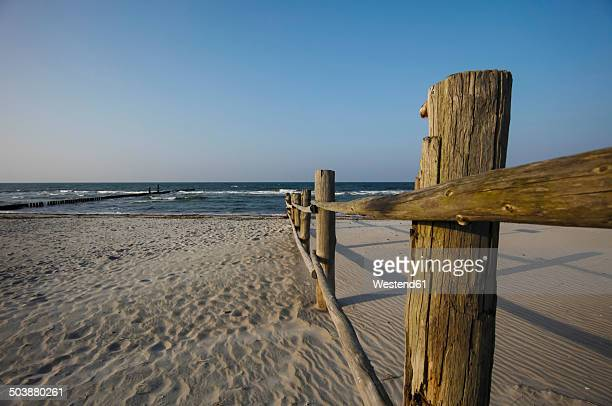 Germany, Mecklenburg-Western Pomerania, Baltic Sea, Wooden fence at beach