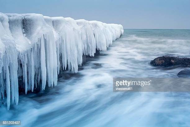 Germany, Mecklenburg-Western Pomerania, Kuehlungsborn, iced jetty at the Baltic Sea