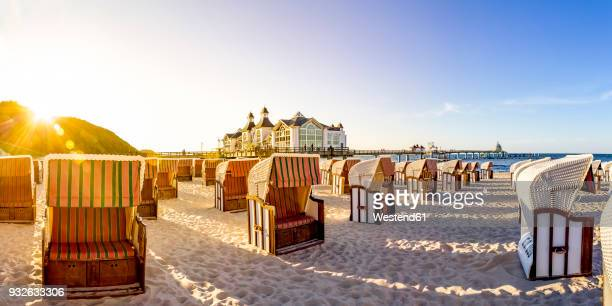 germany, mecklenburg-western pomerania, ruegen, sellin, sea bridge and hooded beach chairs - mecklenburg vorpommern stock pictures, royalty-free photos & images
