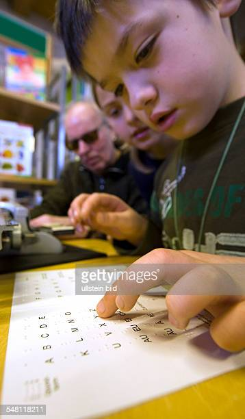 Germany MecklenburgWestern Pomerania Stralsund blind people and pupils are reading together project of the Tour de Braille of the German association...