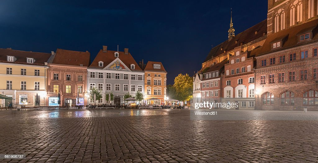 Germany, Mecklenburg-Western Pomerania, Stralsund, Old Town, old market and St. Nicholas' Church in the evening : Stock Photo