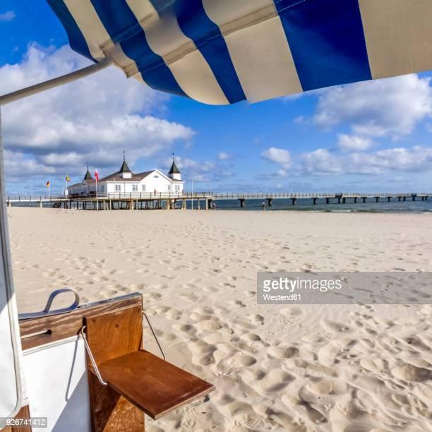 germany, mecklenburg-western pomerania, usedom, ahlbeck, beach, roofed wicker beach chair and sea bridge - ウセドム ストックフォトと画像