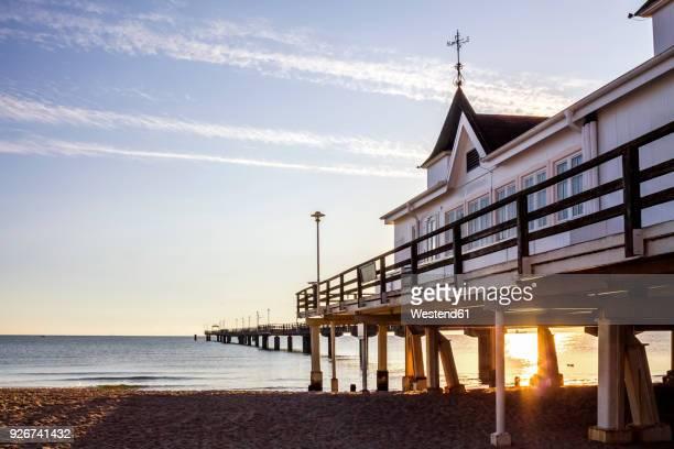 Germany, Mecklenburg-Western Pomerania, Usedom, Ahlbeck, sea bridge at sunset
