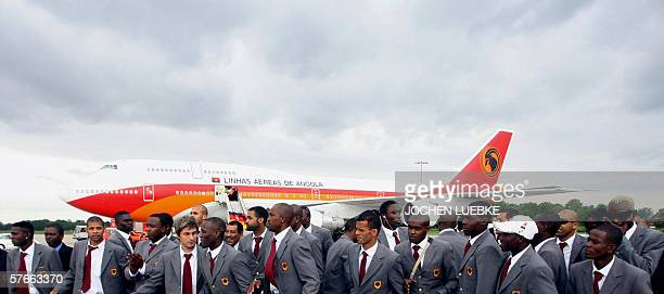 Members of the Angolan national football team prepare to pose for photographers after they arrived 20 May 2006 at the airport of Hanover, western...