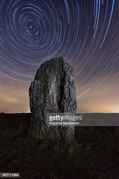 Germany, menhir and star trails