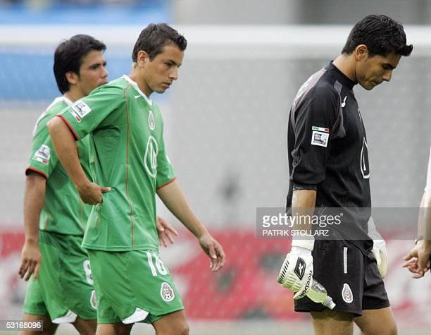 Mexican goalkeeper Oswaldo Sanchez and defender Mario Mendez react at the end of the Confederations cup third place final football match Germany vs...
