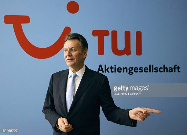 Michael Frenzel, chairman of Europe's leading travel and tourism group TUI, is pictured in front of his company's logo prior to present the annual...