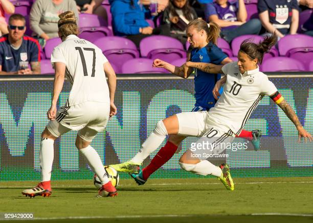 Germany midfielder Dzsenifer Marozsán gets fouled during SheBelieves Cup between Germany and France on March 7th 2017 at Orlando City Stadium in...