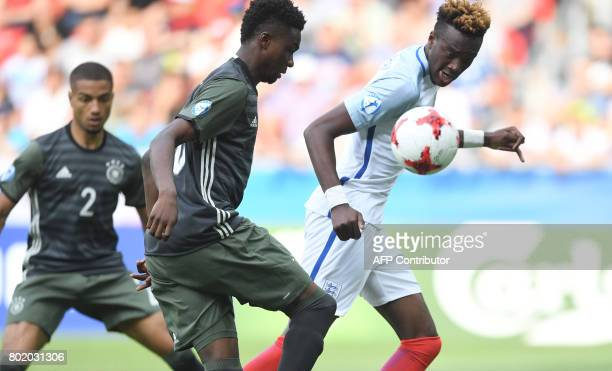 Germany midfielder Gideon Jung and England's forward Tammy Abraham vie for the ball during the UEFA U21 European Championship football semi final...